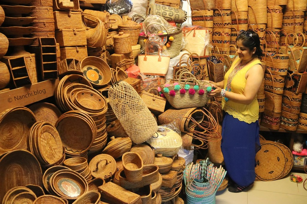 Nanchi seeing handbags, Ubud Market, Ubud, Indonesia