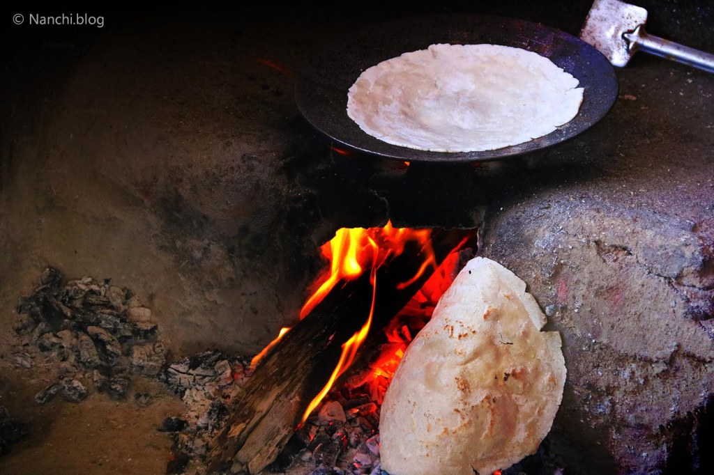 Bhakri in the making on wood fire, Sinhgadh Fort, Pune