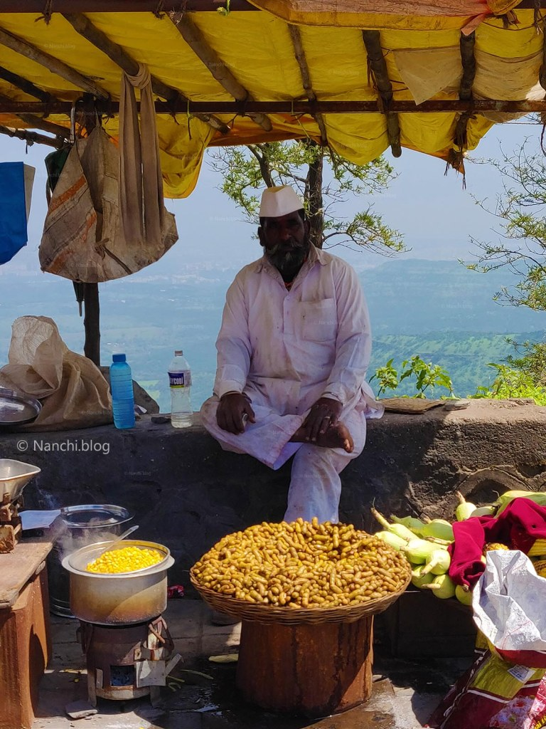 Vendor selling Peanuts, Corn and snacks in parking lot, Sinhagad Fort, Pune