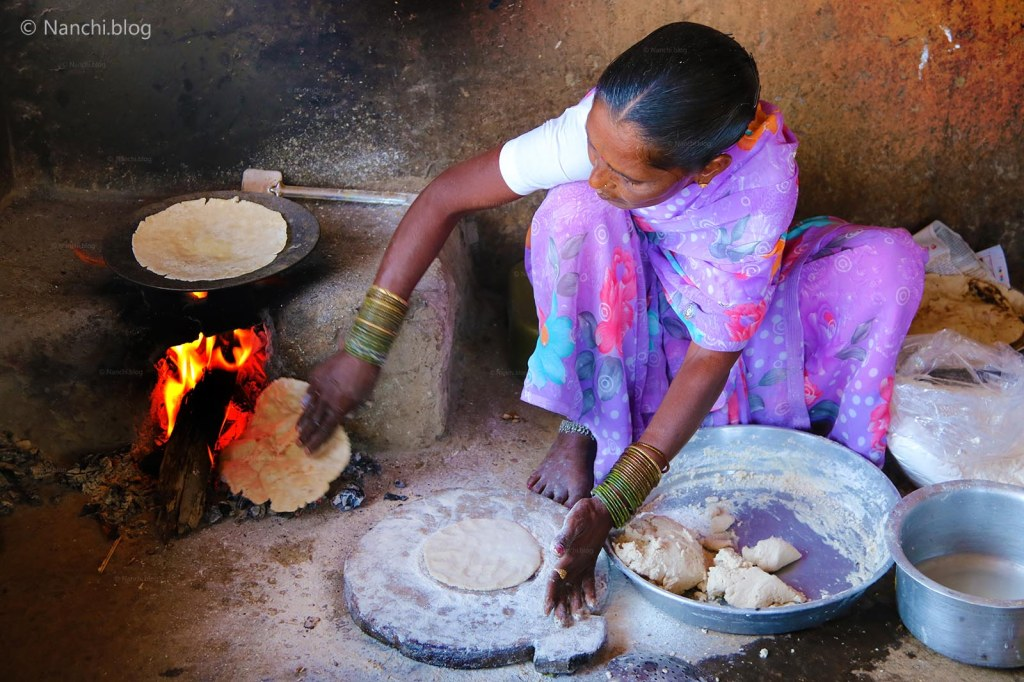 Woman cooking Bhakri on wood fire, Sinhgadh Fort, Pune