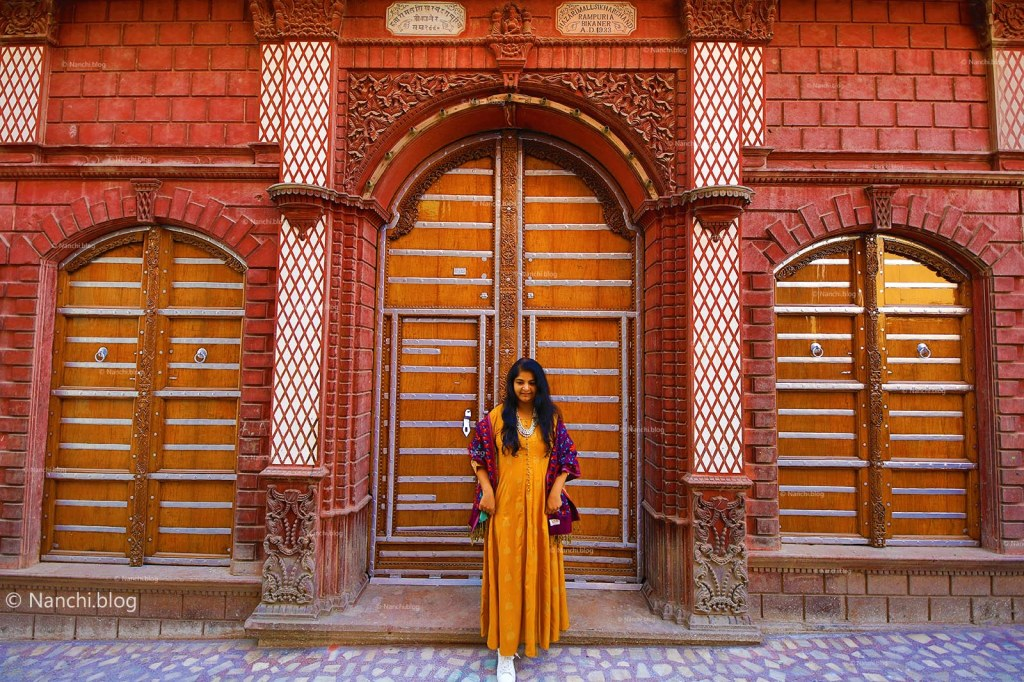 Nanchi in front of old doors at Rampuria Havelis, Bikaner, Rajasthan